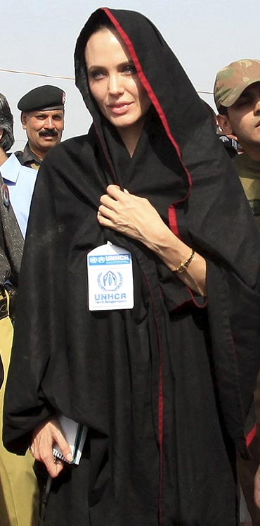 Angelina Jolie arrives at the Jalozai flood victim relief camp during her visit to flood affected areas and relief camps, in Pakistan's northwest Khyber-Pakhtunkhwa Province.