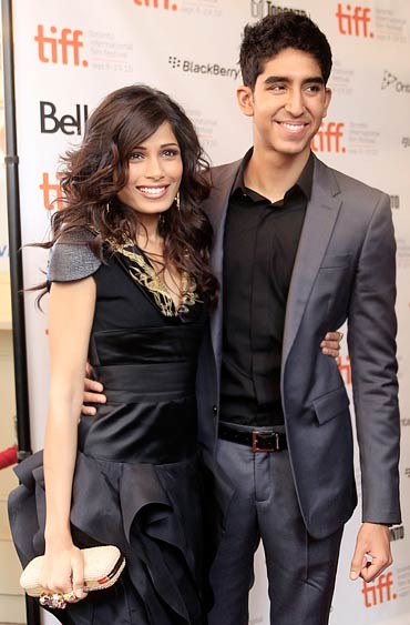 Freida Pinto and Dev Patel at the gala presentation for You Will Meet a Tall Dark Stranger at the 35th Toronto International Film Festival