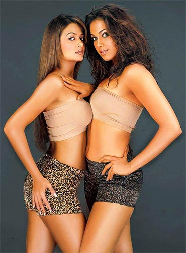 Eesha Koppikar in a scene from her film Girlfriend, co-starring Amrita Arora