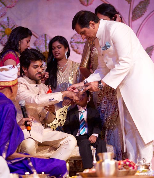 Upasana's father Anil Kamineni applies ittar on Charan