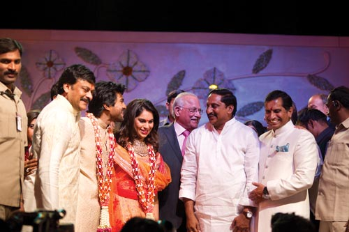 The couple with their families and AP Chief Minister Kiran Kumar Reddy (second from right)
