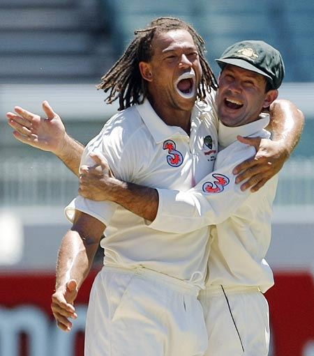 Andrew Symonds congratulates and Ricky Ponting