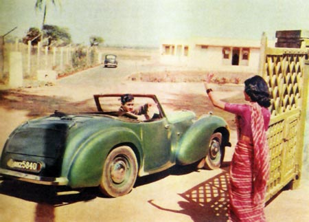 Dev Anand driving off in his green convertible