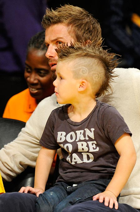 Cruz sits in father David Beckham's lap