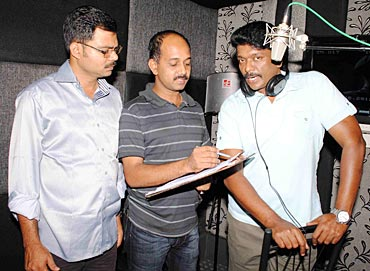 Parthiban (right) at a dubbing session