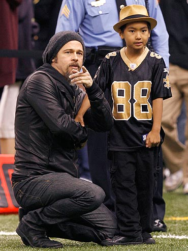 Brad Pitt and Maddox at an NFL's NFC Divisional playoff football game