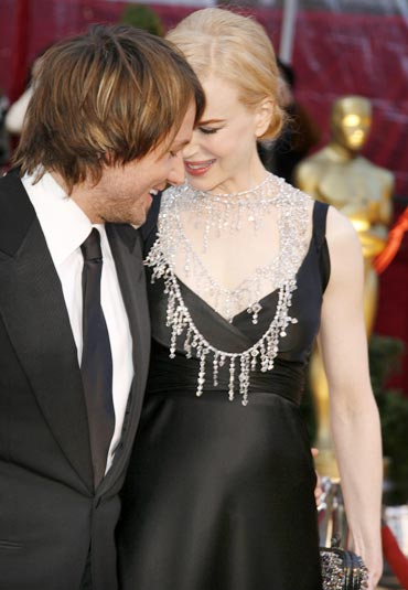 Nicole Kidman arrives with her husband, musician Keith Urban, at the 80th annual Academy Awards