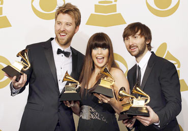 From left to right: Charles Kelley, Hillary Scott and Dave Haywood of country music group Lady Antebellum pose backstage with their awards