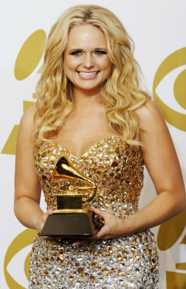 Miranda Lambert poses with her Best Female Country Vocal Performance award for The House That Built Me