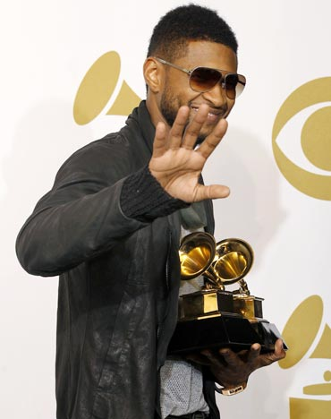 Usher poses with his awards for Best Contemporary R and B Album for Raymond V Raymond and Best Male R and B Vocal Performance for There Goes My Baby
