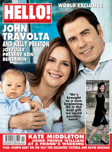 John Travolta and Kelly Preston pose with Benjamin