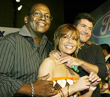 American Idol judges Randy Jackson, Paula Abdul and Simon Cowell pose as they arrive for a party for the finalists of season one in 2004