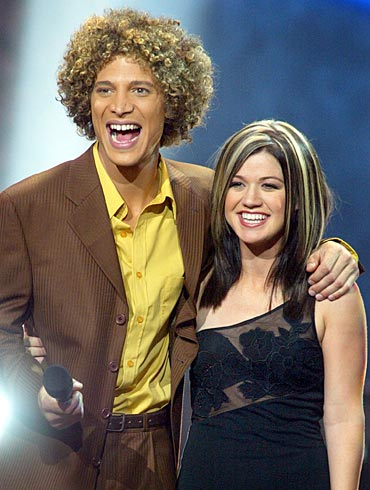 Justin Guarini and Kelly Clarkson hug each other at the conclusion of their performances at the Kodak Theatre in Hollywood
