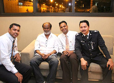 Rajnikanth poses with his fans