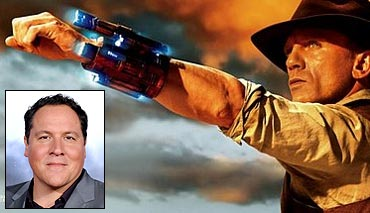 Movie poster of Cowboy And Aliens and (inset)Jon Favreau