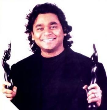A R Rahman holding his Filmfare trophies