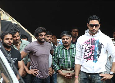 Director Puri Jagannadh (in purple) and Abhishek Bachchan