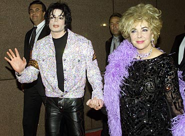 Singer Michael Jackson and actress Elizabeth Taylor arrive at a concert
