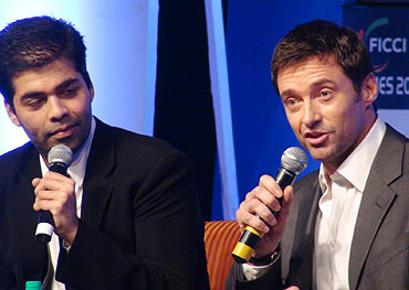Hugh Jackman oozes confidence as Karan Johar chats him up during a Koffee with Karanesque session.