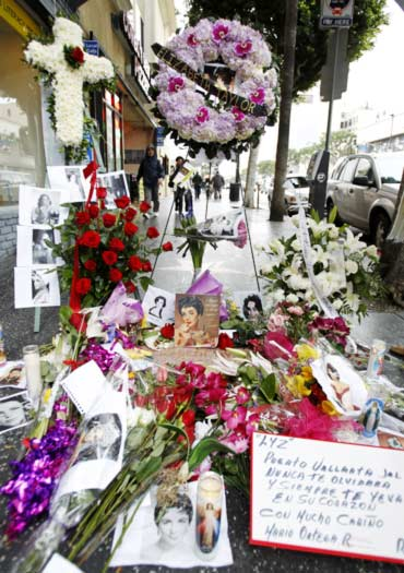 Flowers, photographs and notes from fans adorn the Hollywood Walk of Fame star of Elizabeth Taylor in Hollywood, California