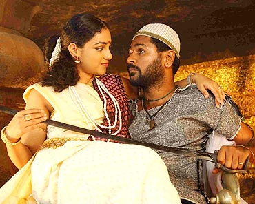 Nithya Menon and Prabhu Deva in Urumi