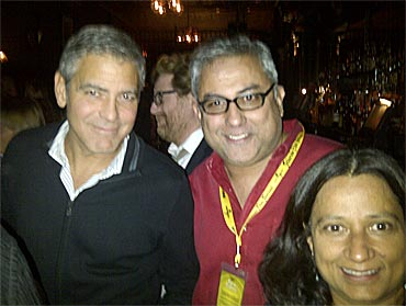 George Clooney and Aseem Chhabra with a friend