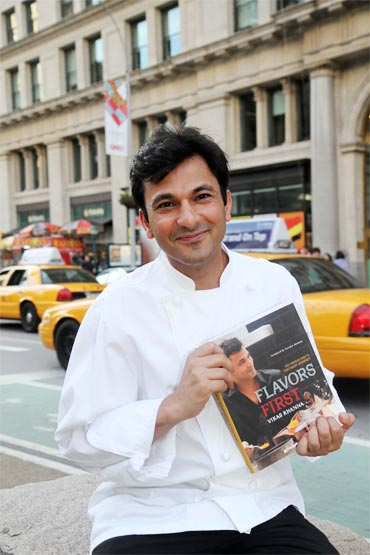 Vikas Khanna with his new book