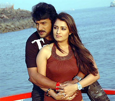 Nikitha Thukral with costar Upendra in Dubai Babu