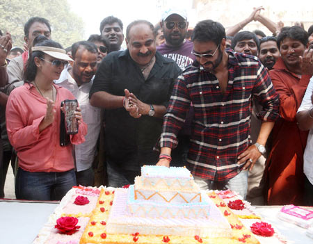 Ajay Devgn cuts the cake on the sets of Son Of Sardaar as Tanishaa and Ashwini Dhir look on