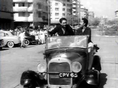 Ashok and Kishore Kumar in Chalti Ka Naam Gadi