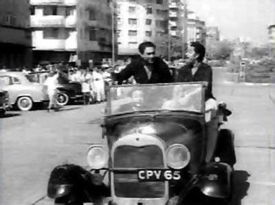 Ashok and Kishore Kumar in Chalti Ka Naam Gadi