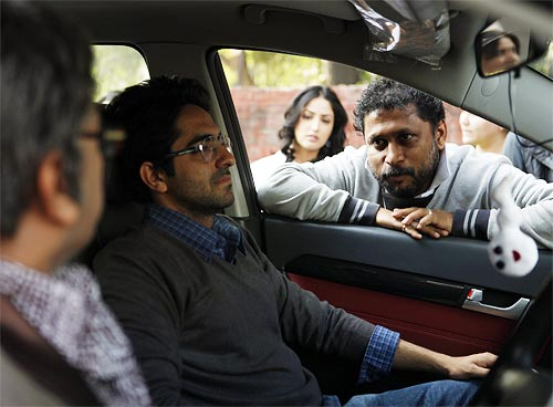 Shoojit Sircar explains a scene to Ayushmann Khurrana and Annu Kapoor as Yami Gautam (not part of that scene) peers in the background