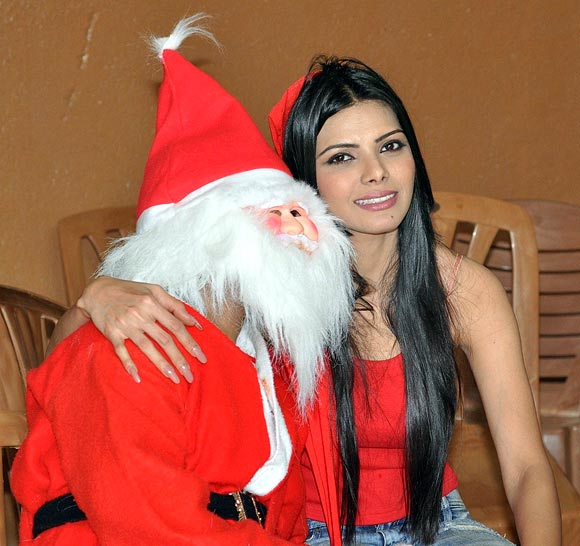 Sherlyn Chopra with the Santa