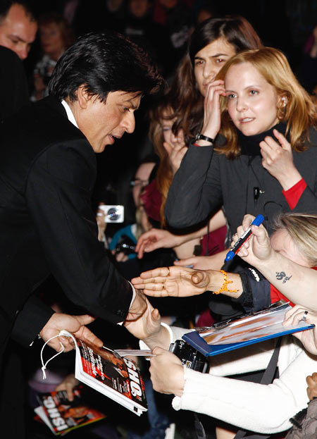 SRK signs autographs for fans