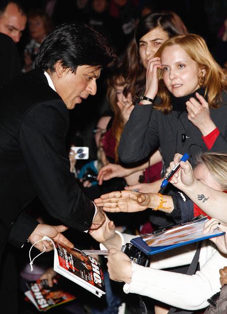 SRK signs autographs for fans