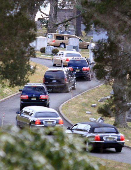 The hearse carrying the body of Whitney Houston arrives for her burial service at the Fairview Cemetery