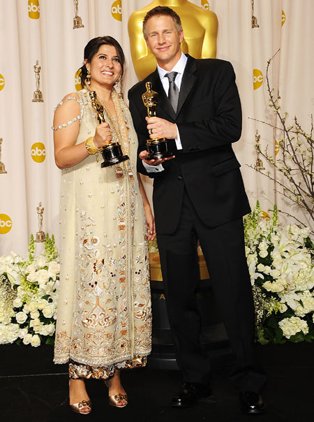 Sharmeen Obaid-Chinoy and Daniel Junge with their Oscars