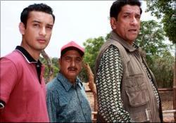 Saheb Bhattacharjee as Topshe, Bibhu Bhattacharya as Jatayu and Sabyasachi Chakraborty as Feluda in Royal Bengal Rahasya