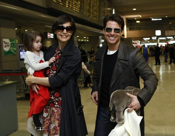 Suri with parents Tom Cruise and Katie Holmes