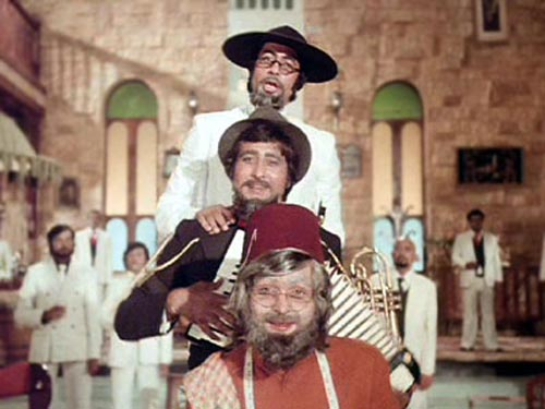 Amar Akbar Anthony directed by Manmohan Desai and scripted by Kader Khan