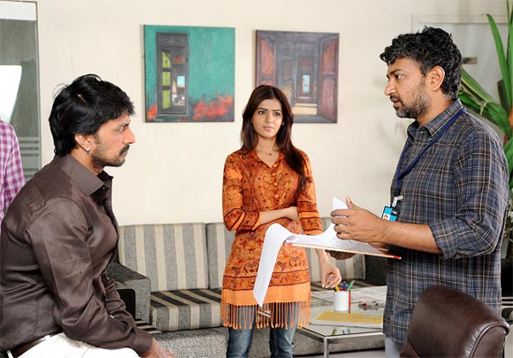 S S Rajamouli explains a scene to Sudeep