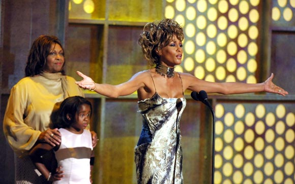 Whitney Houston with mother Cissy (extreme left) and daughter Bobbi Kristina in 2001