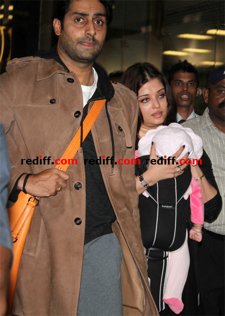 Abhishek Bachchan and Aishwarya Rai Bachchan with daughter Aaradhya