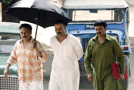 Jameel Khan as Asghar (extreme right) in a scene from Gangs of Wasseypur