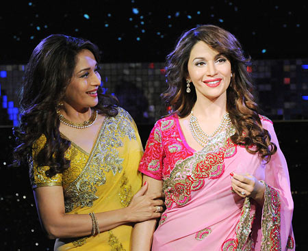 Madhuri Dixit with her wax statue