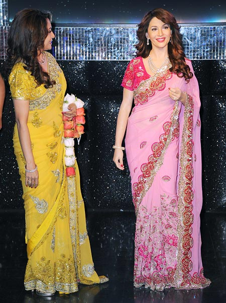 Madhuri Dixit looks at her wax statue
