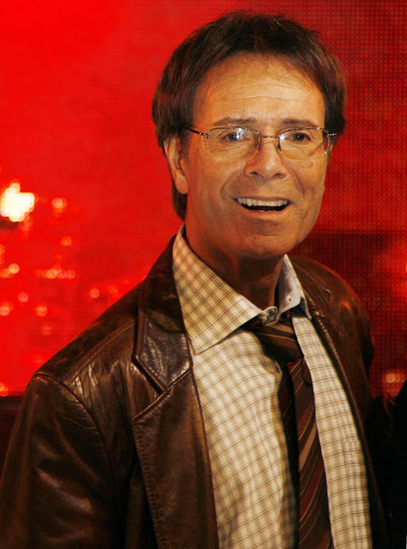 Cliff Richard poses for photographers at a music store in London 2009.