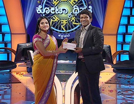 Ramya and Puneeth on the sets of Kannadada Kotiyadhipati