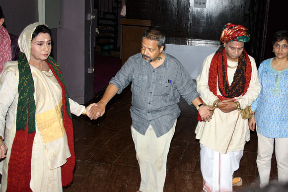 The artistes, including director Sunil Shanbag, pray before the play Sau Saru Jenu Chevat Saru begins in Mumbai