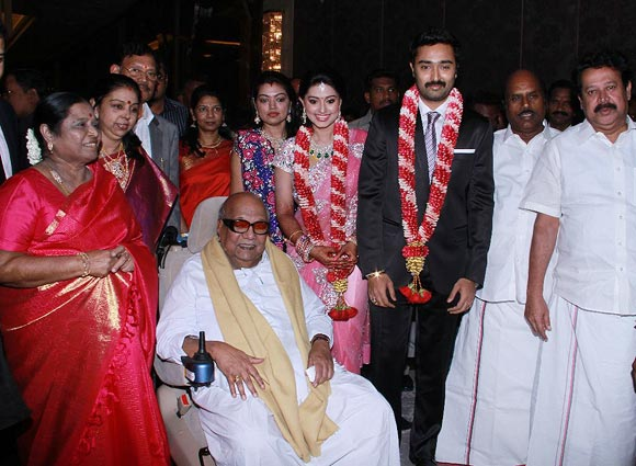 Sneha and Prasanna (wearing garlands) pose with Karunanidhi